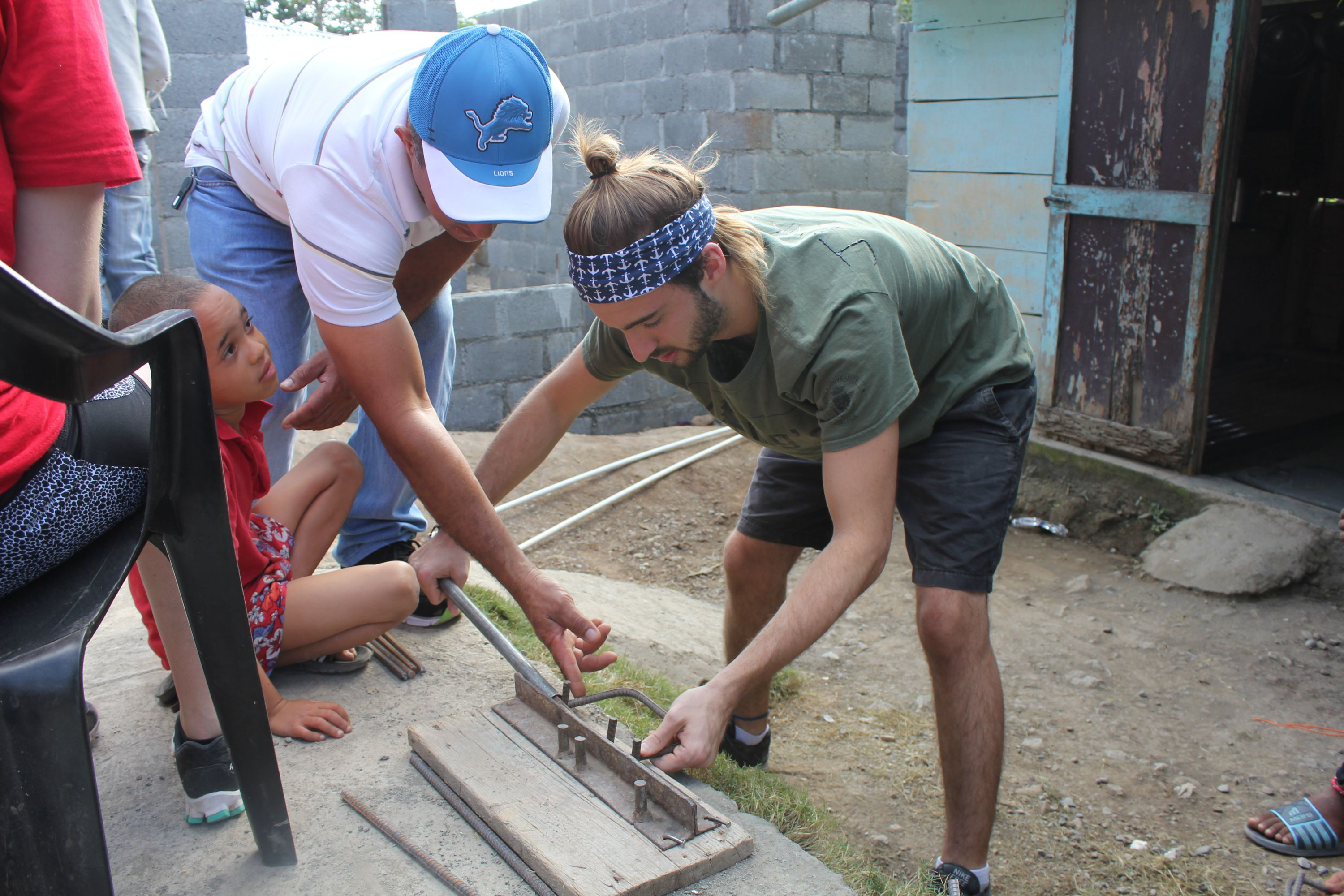(Image: King's student helping build a home in the Dominican Republic)