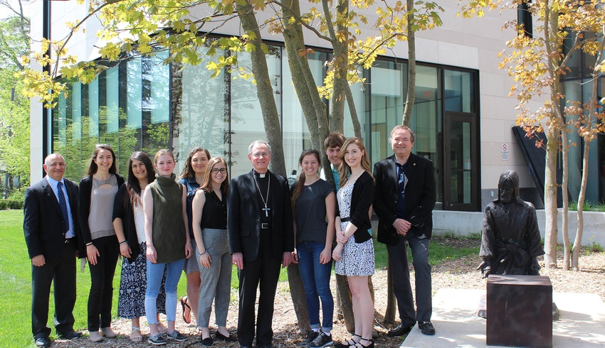 Students in Catholic Studies for Teachers enjoy visit with Bishop